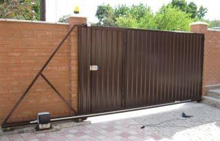 Фото процесса производства Откатные ворота из профнастила в Москве